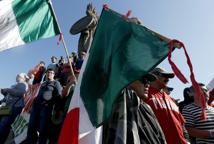 TIJUANA, MEXICO - NOV. 18, 2018. Hundreds of Tijuana residents hold a protest and rally at the Cu