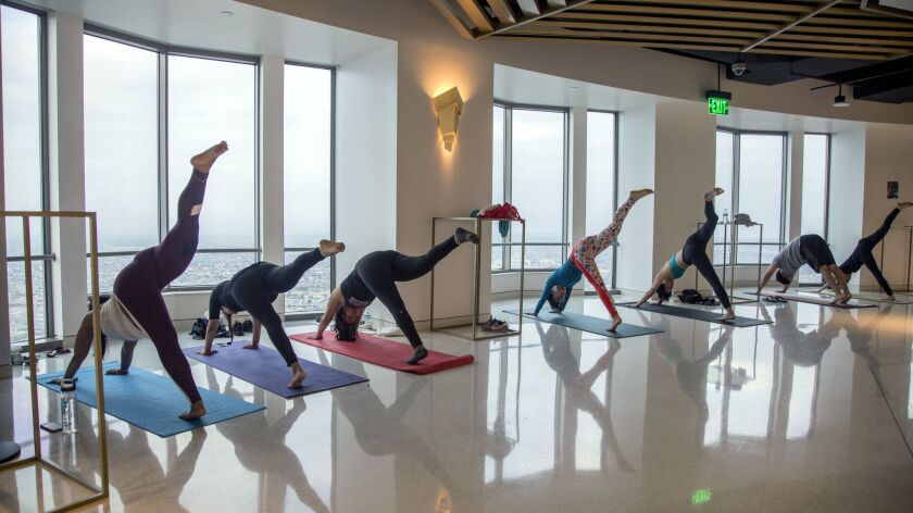 Yoga at OUE Skyspace, which will host a summer series of yoga dance parties. The first is City Light