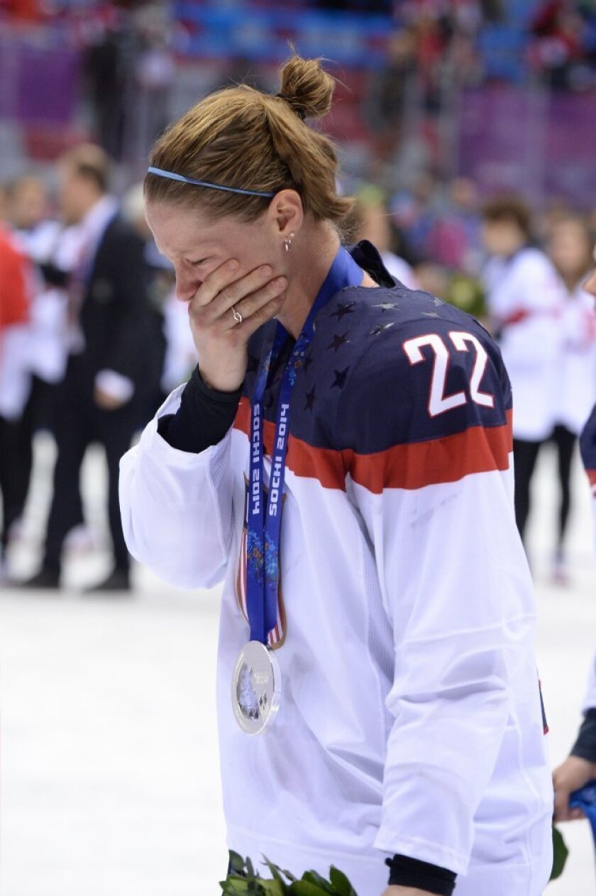 American hockey player Kacey Bellamy cries during the medal ceremony at the Sochi Winter Olympics.