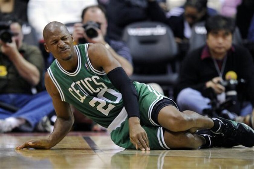 FILE - In this Jan. 22, 2012, file photo, Boston Celtics guard Ray Allen leans on the floor after he was injured during the first half of an NBA basketball game against the Washington Wizards in Washington. The shortened training camp and frenetic pace of this condensed NBA season is starting to take its toll on the players. Injuries are on the rise as players march through this grueling season. (AP Photo/Nick Wass, File)