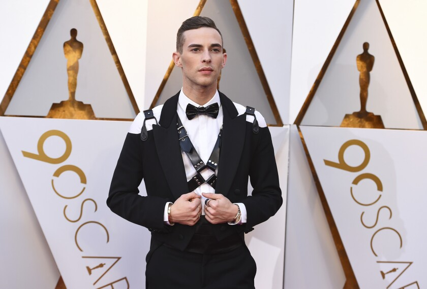Adam Rippon arrives at the Oscars on Sunday at the Dolby Theatre in Los Angeles.