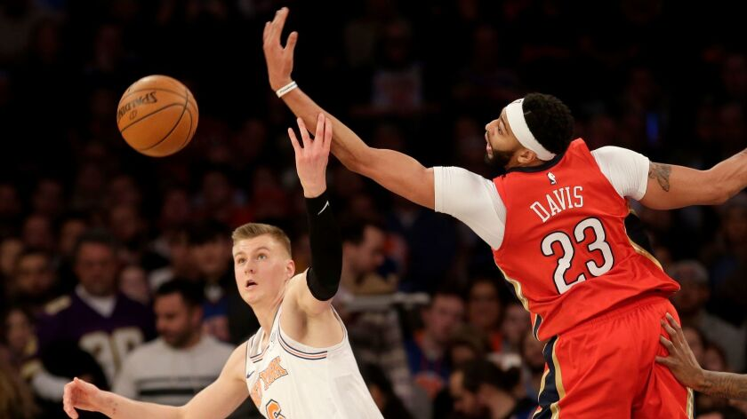 New Orleans Pelicans' Anthony Davis and New York Knicks' Kristaps Porzingis fight for a rebound during the second half.