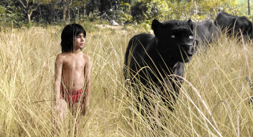 "Mowgli (Neel Sethi) and Bagheera (voice of Ben Kingsley) embark on a journey in ""The Jungle Book."""