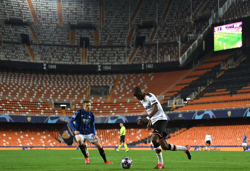 Atalanta's Josip Ilicic, left, and Valencia's Geoffrey Kondogbia in action during the UEFA Champions League round of 16 second leg match in Valencia, Spain on Tuesday.