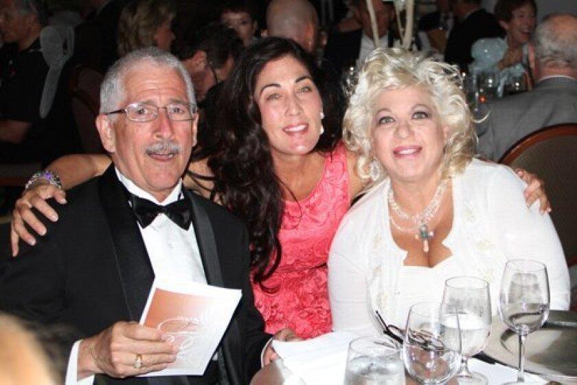 Nicolas Reveles, Angel Faces Board Member Mary Murray and Lesia Cartelli, founder. Courtesy Photo