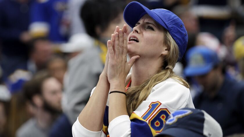 A St. Louis Blues fan reacts as the Boston Bruins pull ahead during the third period of Game 6 of th