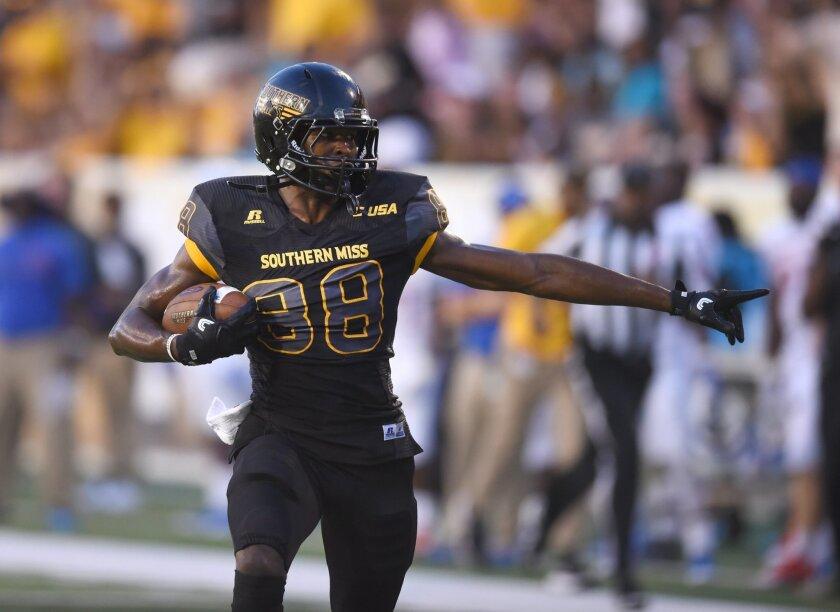 Southern Mississippi wide receiver Isaiah Jones runs in for a touchdown against Savannah State during an NCAA college football game Saturday, Sept. 10, 2016, in Hattiesburg, Miss. (Susan Broadbridge/Hattiesburg American via AP)