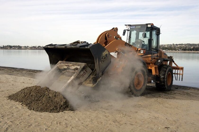 San Diego park and recreation crews began removing fire rings from Fiesta Island last December.