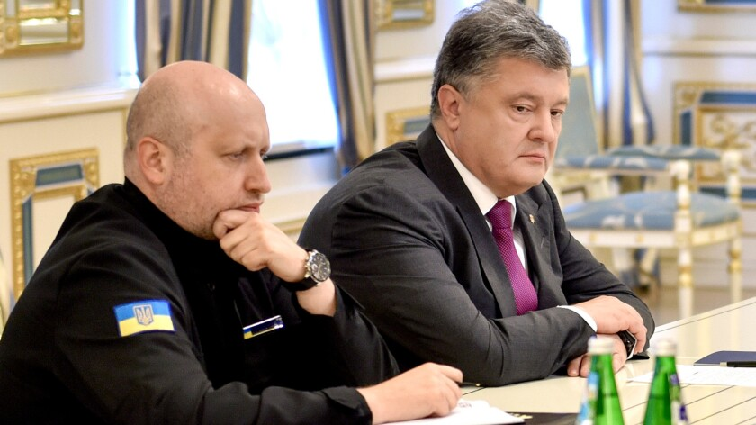 Ukrainian President Petro Poroshenko, right, and Oleksandr Turchynov, head of Ukraine's Defense and Security Council, chair the council extraordinary session in Kiev, the capital, on Aug. 11, 2016.