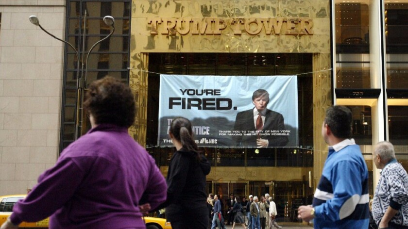 "A sign from Donald Trump's television show, ""The Apprentice, "" hangs on Trump Tower in New York in 2004.(Bebeto Matthews / Associated Press)"