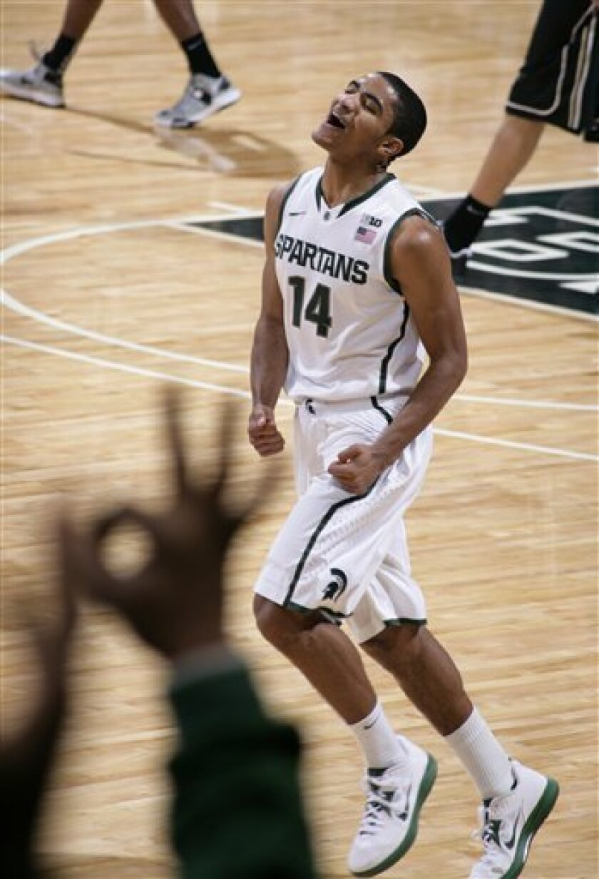 Michigan State's Gary Harris celebrates after Purdue called a timeout after Harris hit a 3-pointer during the first half of an NCAA college basketball game, Saturday, Jan. 5, 2013, in East Lansing, Mich. (AP Photo/Al Goldis)