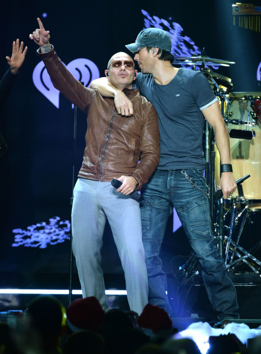 Pitbull (left) and Enrique Iglesias will bring their current tour to San Diego in October. (Larry Busacca/Getty Images for Clear Channel)