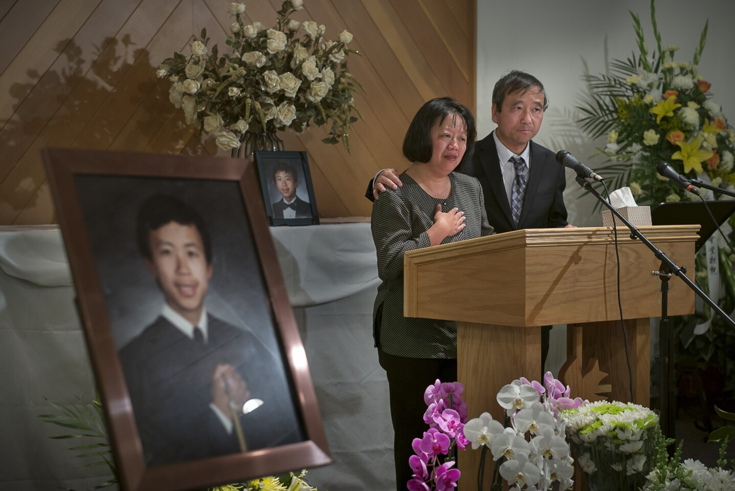 Kelly Wang and Johnny Chen speak to the crowd at a memorial at Chinese Church in Christ for their son George Chen, a student at UC Santa Barbara, who was one of those killed in last month's rampage in Isla Vista, Calif.