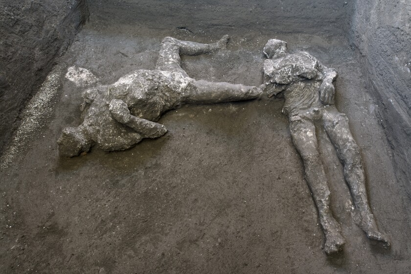 The casts of what are believed to have been a rich man and a man he enslaved fleeing the volcanic eruption of Vesuvius.
