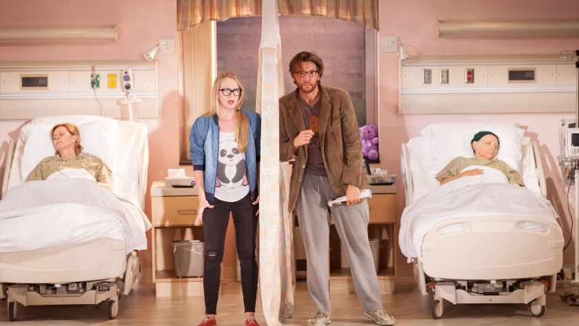 """Halley Feiffer and Jason Butler Harner stand at the center of the Geffen Playhouse's """"A Funny Thing Happened on the Way to the Gynecologic Oncology Unit at Memorial Sloan Kettering Cancer Center of New York City,"""" also starring JoBeth Williams, left, and Eileen T'Kaye."""