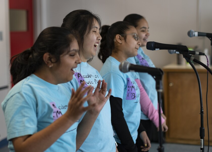 The singers of Acabella rehearse at the Academy of Music for the Blind in Whittier. From left: Riya Golakiea, 12; Dorothy Cho, 14; Brianna Vieyra, 12; and Natalie Fuentes, 12.