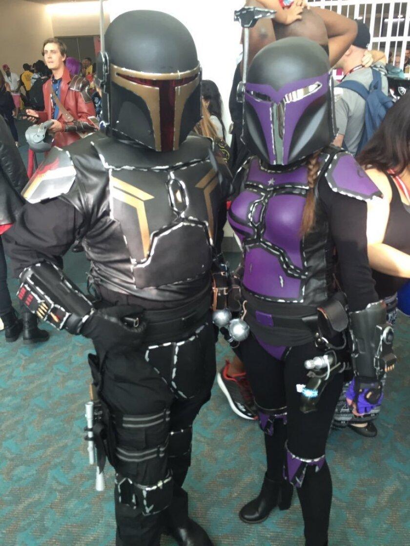Comic-Con cosplayers Vincent Cortez, 30, of Las Vegas and Megan Cortez, 29, of Las Vegas dress as Star Wars Bounty Hunters.