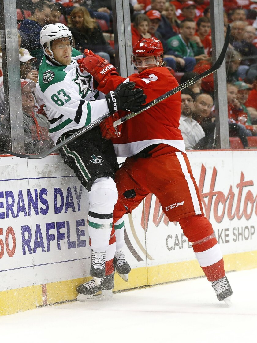 Detroit Red Wings defenseman Brendan Smith (2) checks Dallas Stars right wing Ales Hemsky (83) in the first period of an NHL hockey game, Sunday, Nov. 8, 2015 in Detroit. (AP Photo/Paul Sancya)