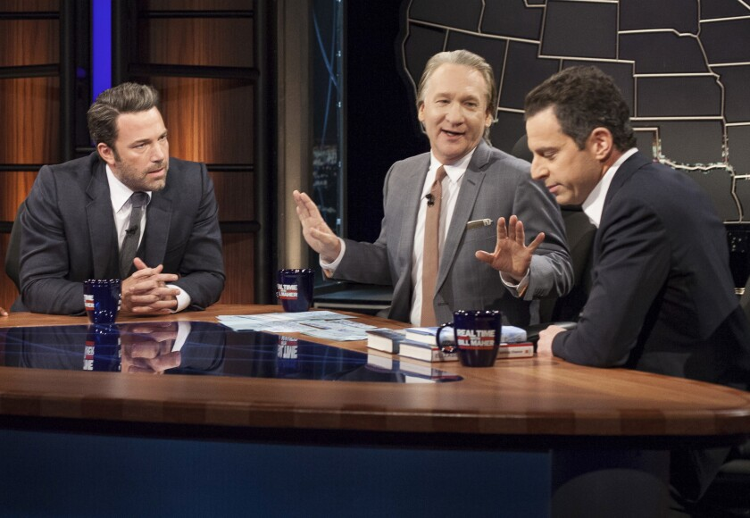 HBO talk show host and political satirist Bill Maher, center, with actor Ben Affleck, left, and author Sam Harris.