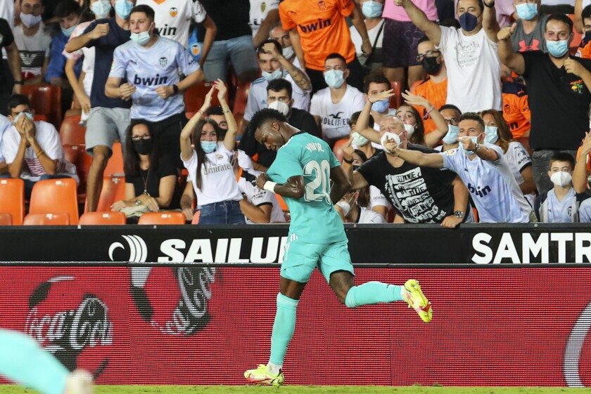 Real Madrid's Vinicius Junior celebrates after scoring his side's first goal during a Spanish La Liga soccer match between Valencia and Real Madrid at the Mestalla stadium in Valencia, Spain, Sunday, Sept. 19, 2021. (AP Photo/Alberto Saiz)