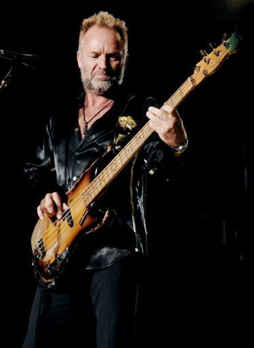 In this Aug. 7, 2008 file photo, lead vocalist and bassist Sting and his band The Police perform their farewell concert at Madison Square Garden in New York. (AP Photo/Evan Agostini, file)