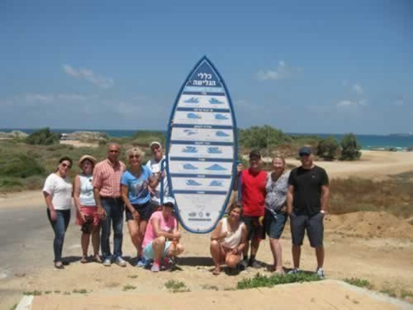 Surfers from California gather at a designated surf spot in Israel saved by the Ashdod surfers.