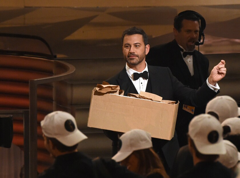 Host Jimmy Kimmel hands out peanut-butter-and-jelly sandwiches during the 68th Emmy Awards show in Los Angeles.