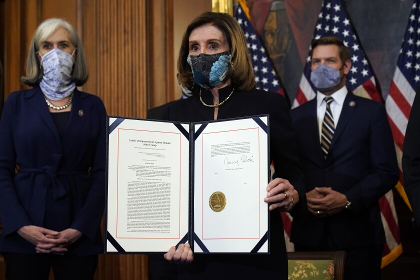 House Speaker Nancy Pelosi of San Francisco displays the signed article of impeachment