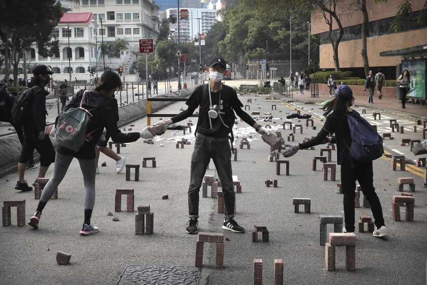 Rioters are building road bloackage to stop police vehicles from getting into the university