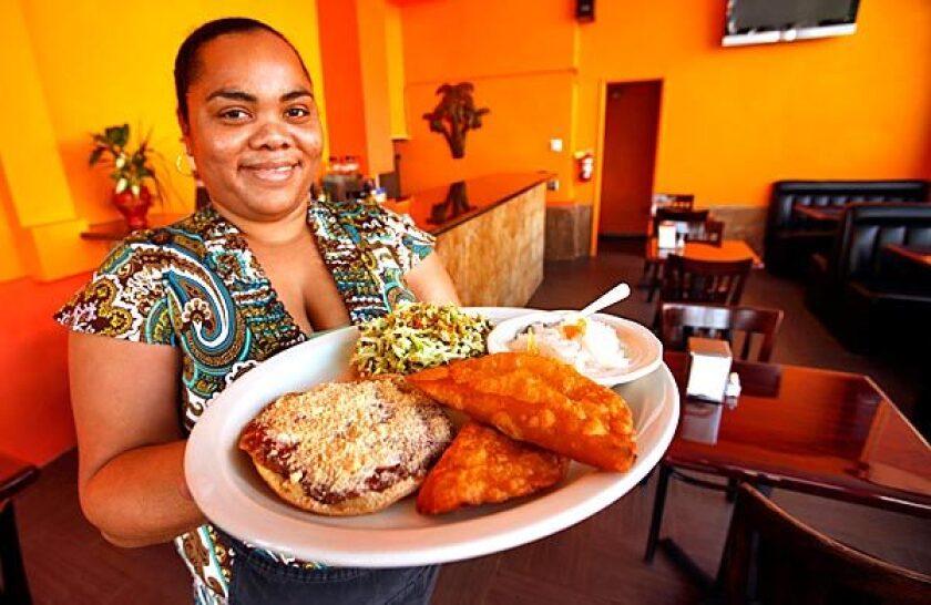 Tifara Smith shows a sampler platter at Flavors of Belize.