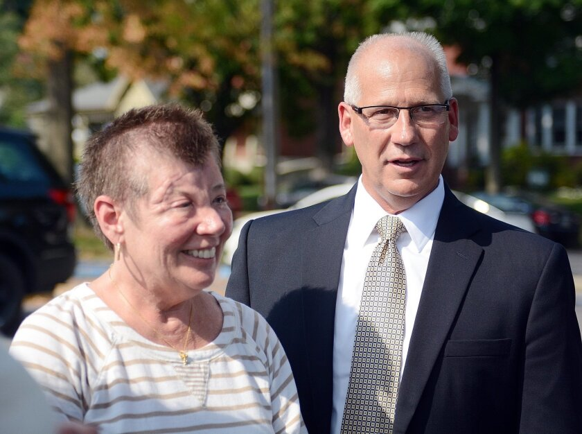 FILE - In this Sept. 3, 2015 file photo, Sharon and Randy Budd talk with friends and relatives outside the Union County Court House in Lewisburg, Pa., after three young men were sentenced to time behind bars for throwing a rock off a highway overpass in central Pennsylvania, causing severe brain trauma to Sharon, an Ohio teacher. Randy Budd, has died at age 55. Harry Campbell, chief investigator for the Stark County Coroner's office, told The Associated Press on Sunday, Aug. 7, 2016, that Budd died of a self-inflicted gunshot wound and was pronounced dead at his Uniontown, Ohio, home late Saturday. (Amanda August/The Daily Item via AP, File)