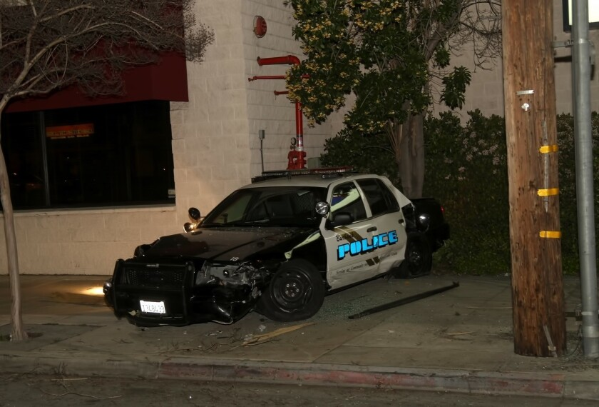 Driver collides with Burbank police car