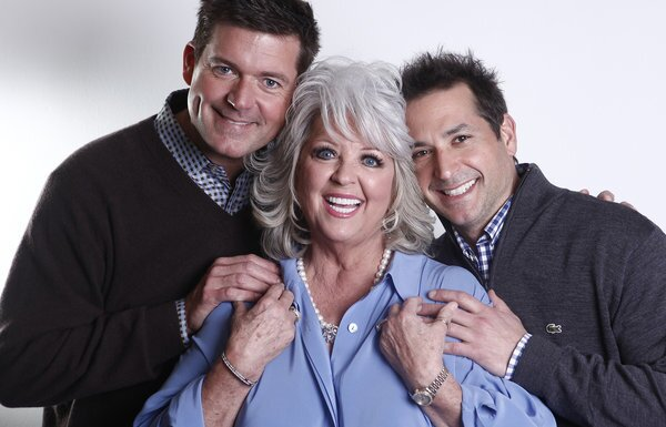 Paula Deen's two sons, Jamie, left, and Bobby, defended their mother against accusations of racism, saying they were raised in a loving home where bigotry did not exist.