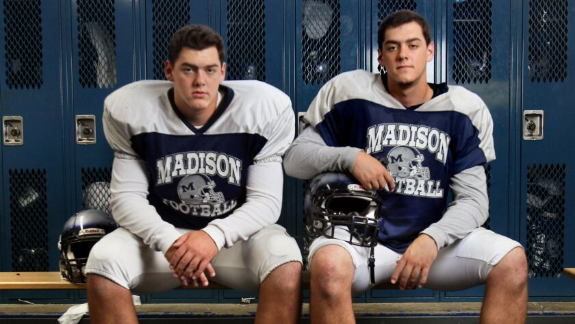 Twins Jake (left) and Sam Vermillion ring up sacks on defense and open holes on offense for Madison.