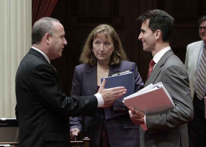 State Senate President Pro Tem Darrell Steinberg, left, talks with Sen. Ellen Corbett and Senate Budget Committee Chairman Mark Leno in 2011. Corbett was appointed to a state board after being termed out of office