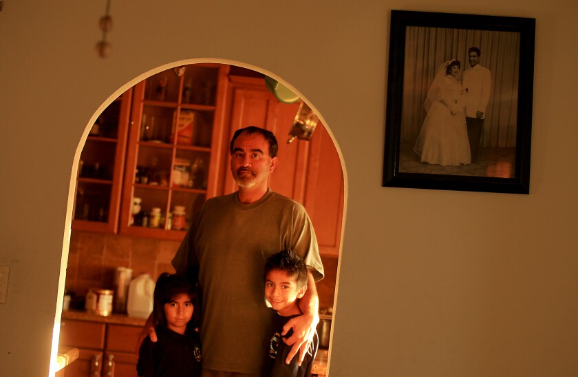 """Martin Saldana, here with son Dimaggio and daughter Darlene, walked out of the Long Beach Boeing plant for the last time Friday afternoon. """"I lose a lot of sleep,"""" he said. """"I've still got to provide for them."""""""