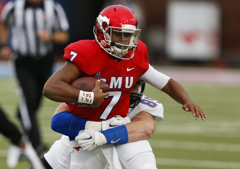SMU quarterback Darrel Colbert Jr. (7) is tackled by Tulsa defensive tackle Thomas Shamet (89) during the first half of an NCAA college football game, Saturday, Oct. 31, 2015, in Dallas. (AP Photo/Jim Cowsert)