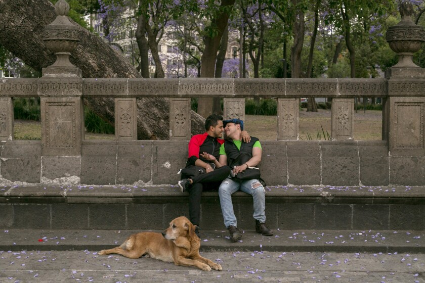 Eduardo, 26, left, and Jorge, 35, embrace in Mexico City's Alameda Central park. Like many public spaces in Mexico City, the park is often filled with couples publicly displaying their affection.