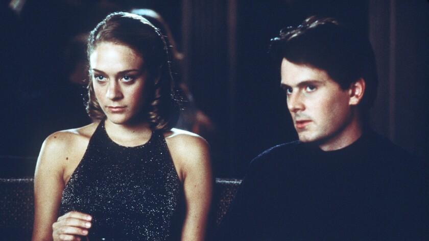"Chloë Sevigny and Chris Eigeman in the 1998 movie ""The Last Days of Disco."""