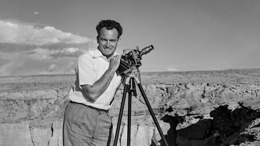 In this photograph taken in 1935, Barry Goldwater smiles and poses with his camera at Coal Mine Canyon between Tuba City and the Third Mesa in northeastern Arizona.