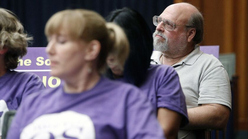 Measure QS opponent Larry Applebaum, sitting behind a group of Measure QS supporters at the Burbank