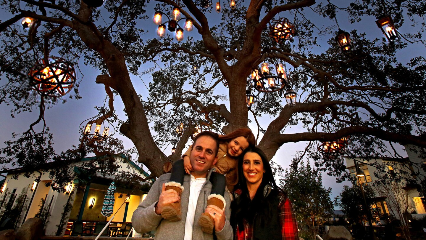 Matt and Amy Fuccile with daughter Charlie beneath one of Rancho Mission Viejo's chandelier trees.