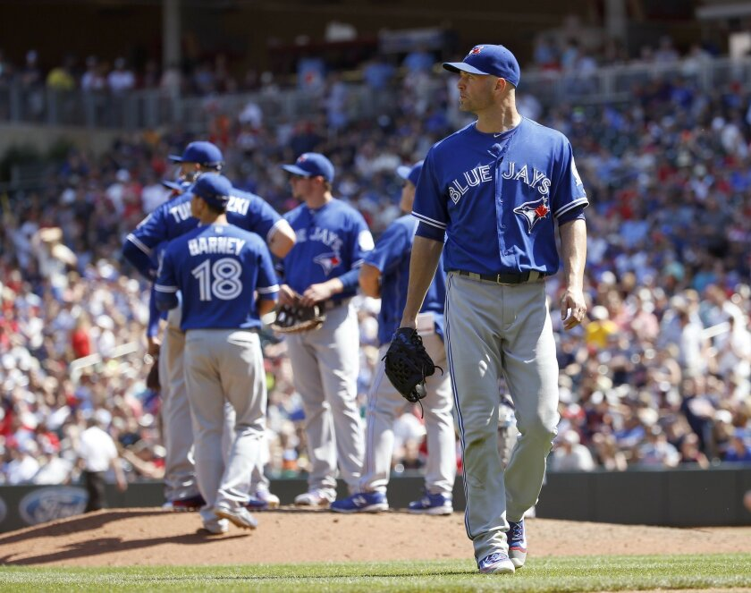 Toronto Blue Jays starting pitcher J.A. Happ leaves the mound as he is replaced by relief pitcher Gavin Floyd during the eighth inning of a baseball game against the Minnesota Twins in Minneapolis, Saturday, May 21, 2016. The Twins won 5-3. (AP Photo/Ann Heisenfelt)