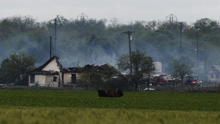 A general view of the remains of a fertilizer plant and other buildings and vehicles after the plant exploded in West, Texas.