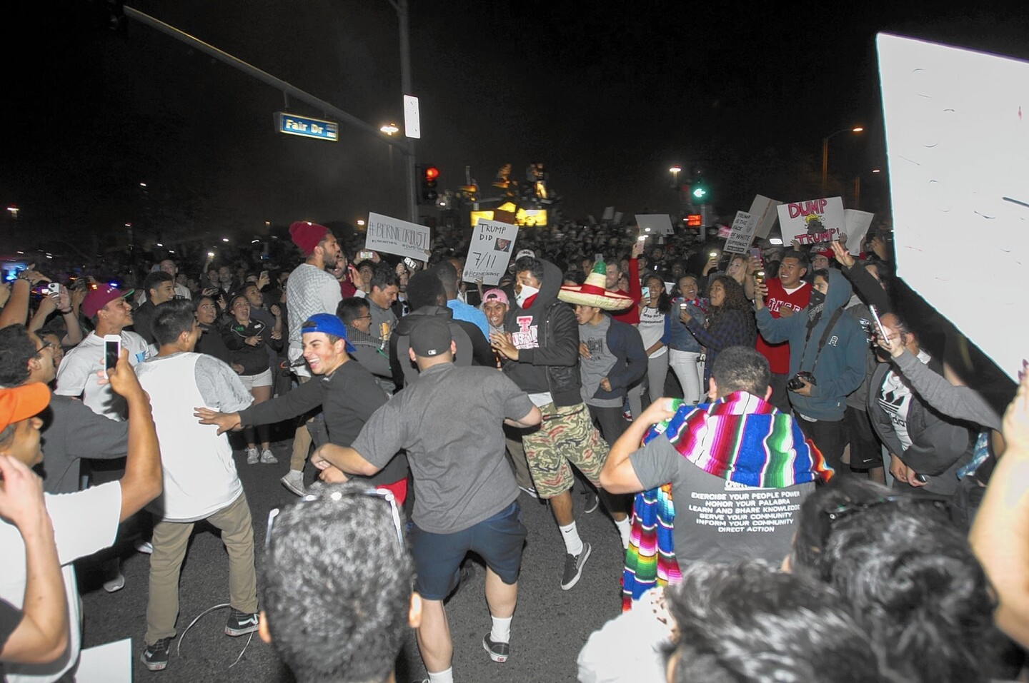 A crowd blocks the street at the corner of Fairview Road and Fair Drive in Costa Mesa on Thursday following a Donald Trump rally at the Orange County fairgrounds.