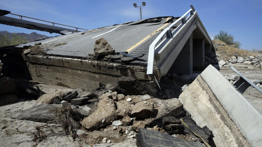 The eastbound bridge of Interstate 10 between Coachella and the Arizona border lies in ruins after yesterday's flash floods washed out the bridge over a desert wash. Traffic in both directions of the major east-west highway has been stopped indefinitely while engineers assess the damage.