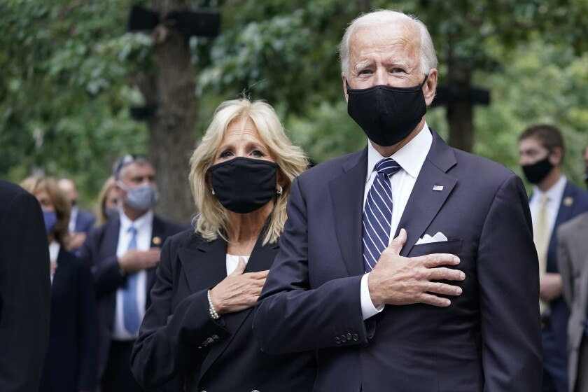Joe and Jill Biden with hands over their hearts at a New York ceremony marking 19 years since the 9/11 terrorist attacks.