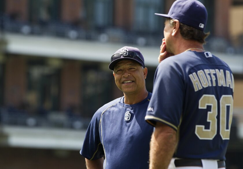 Padres bench coach Dave Roberts (left) has interviewed for the Seattle Mariners' managerial opening.