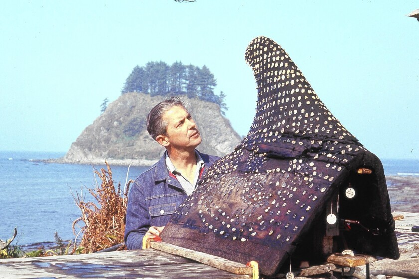 Richard Daugherty examines a whale saddle that was carved out of cedar and encrusted with 700 sea otter teeth. The Makah were prolific whalers. In the course of 11 years of excavation at a Makah site near Lake Ozette, Wash., Daughtery and his team uncovered more than 55,000 artifacts.