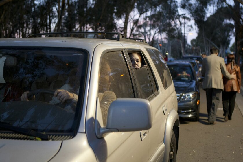 """Judy Bauerlein (front seat) and Wendy Waddell (rear window) in Steve Lozier's play """"We Wait,"""" part of La Jolla Playhouse's """"Without Walls"""" series production of """"The Car Plays: San Diego."""""""